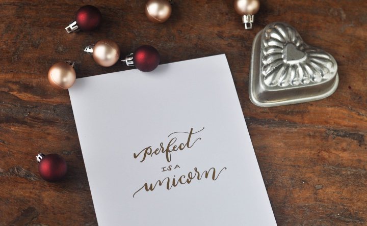 Calligraphy 'Perfect is a unicorn' as freebie