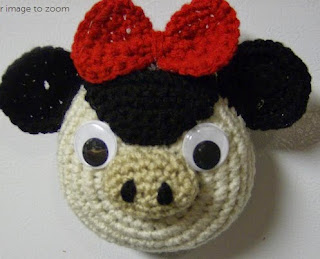 http://www.craftsy.com/pattern/crocheting/home-decor/cora-fridgie-a-crochet-pattern/50729