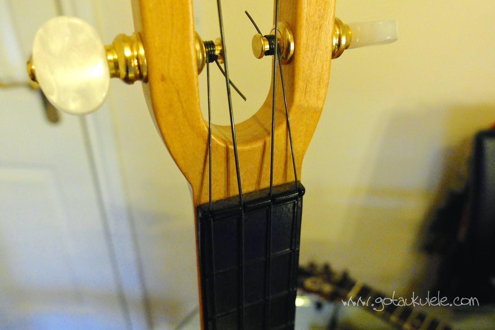 Aquila Lava Ukulele Strings Fluke headstock