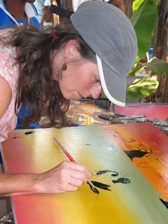 Studying tingatinga painting technique