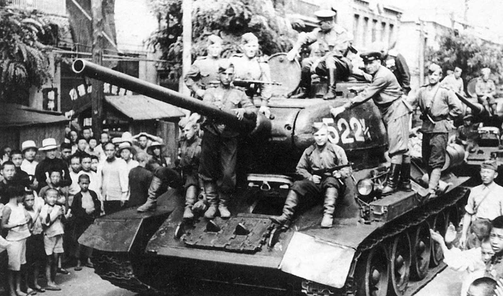 On August 9, 1945, the Soviet Union invaded Manchuria, sending more than a million soldiers to attack Japan's Kwantung Army. The Soviets quickly defeated the poorly-prepared Japanese, putting further pressure on them to surrender to the Allies. Here, a column of tanks appears on the streets of the Chinese city of Dalian.