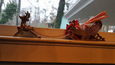 small brass sleigh drawn by 2 reindeer loaded with peppermint
