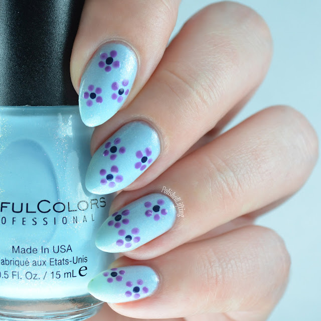 Blue nail polish with flowers