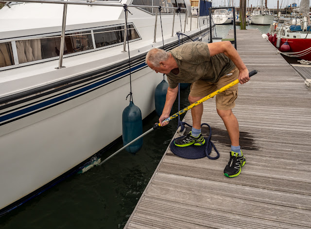 Photo of Phil cleaning Ravensdale's hull below the waterline