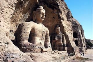 stone_carved_buddha_statue_sitting_meditation_posture_image.jpg