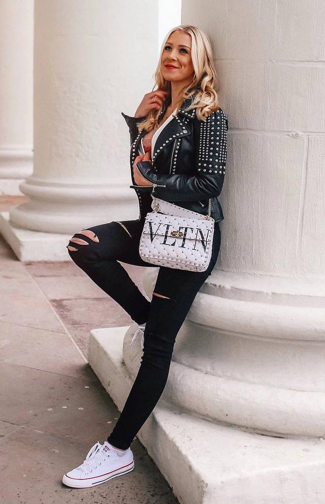 how to wear a pair of white converse : black rips + black biker jacket + white crossbody bag