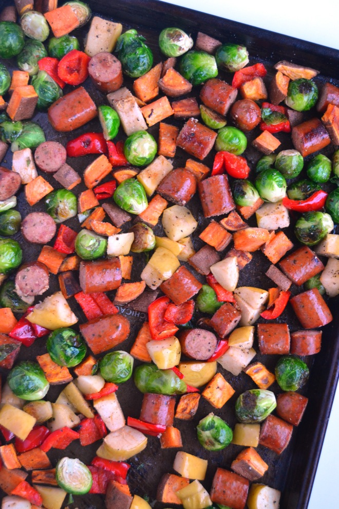 Sheet Pan Sausage, Apples and Vegetables is all made on one pan and is ready in 30 minutes! Loaded with roasted apples, sausage, sweet potatoes, red bell peppers and Brussels Sprouts. www.nutritionistreviews.com