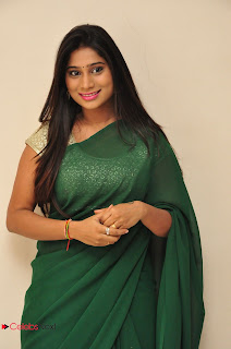 Midhuna Waliya Stills in Green Saree at Anushtanam movie Audio Launch ~ Celebs Next