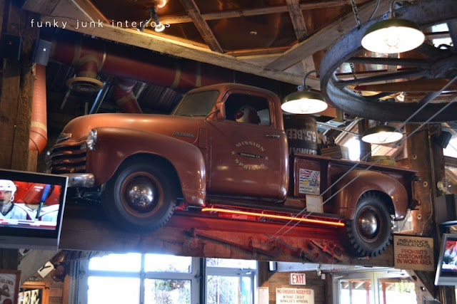 An old truck hung from the rafters at Mission Springs Brewing Company, a junk-filled pub and restaurant.