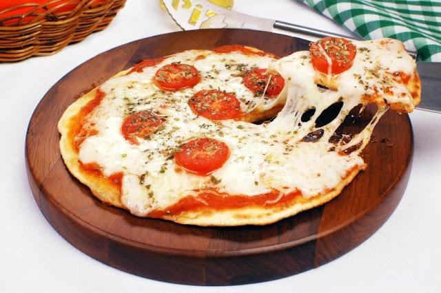 Receita de pizza frita italiana (Imagem: Reprodução/Guia da Cozinha)