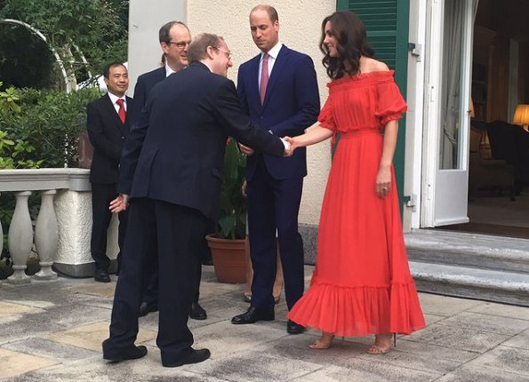 Kate Middleton's dress is by Alexander McQueen Off-the-shoulder shirred cotton and silk-blend. Simone Rocha Crystal earrings, Prada Pumps