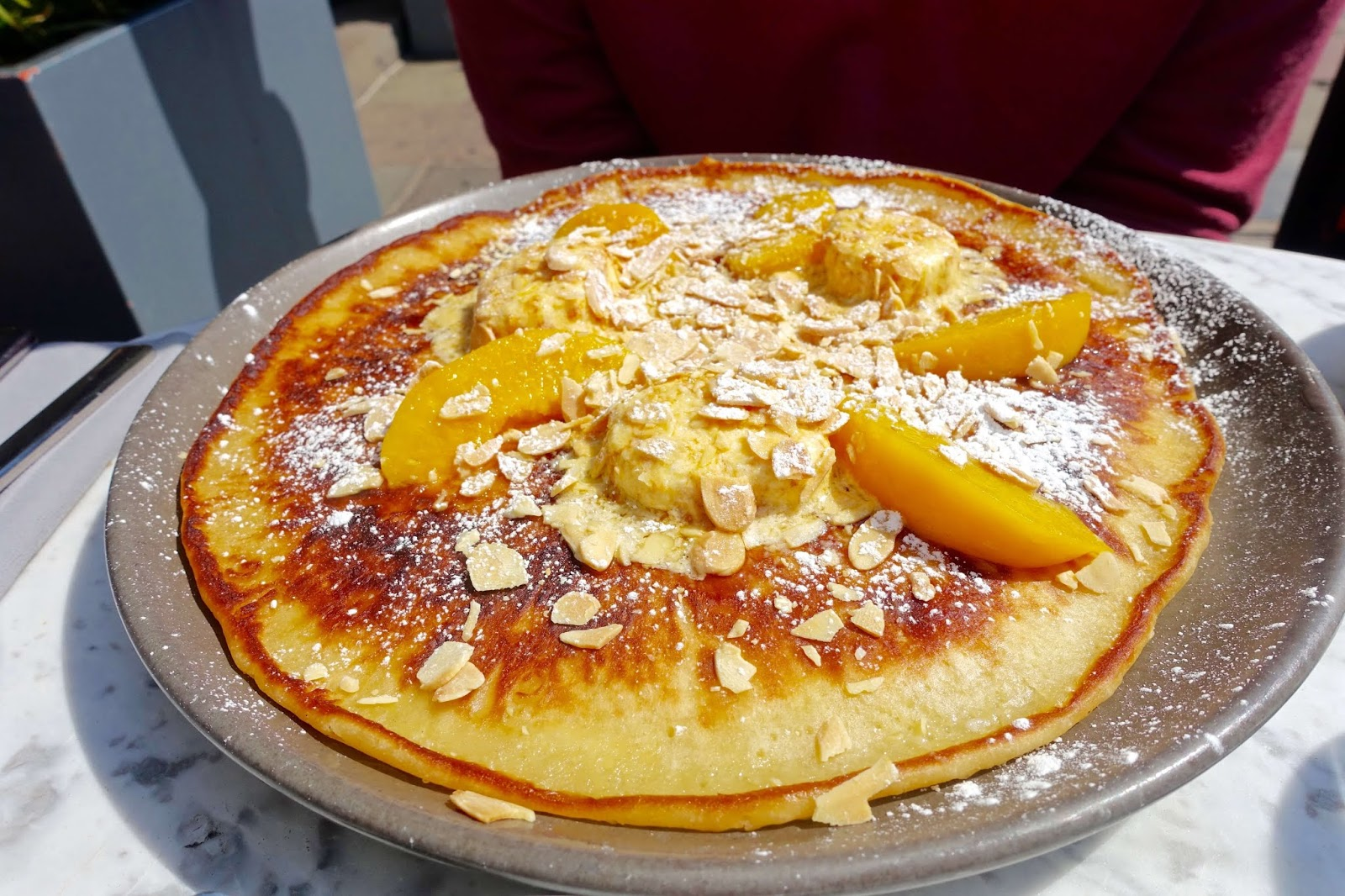 buttermilk pancake with honeycomb butter and peaches at tigerlily edinburgh