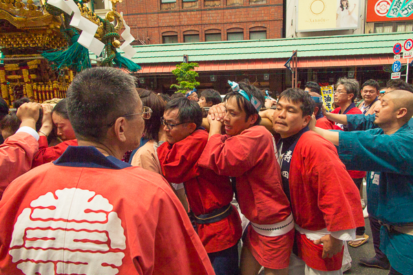 Shrine bearers shouldering a shrine at the Sanja Matsuri 2016.