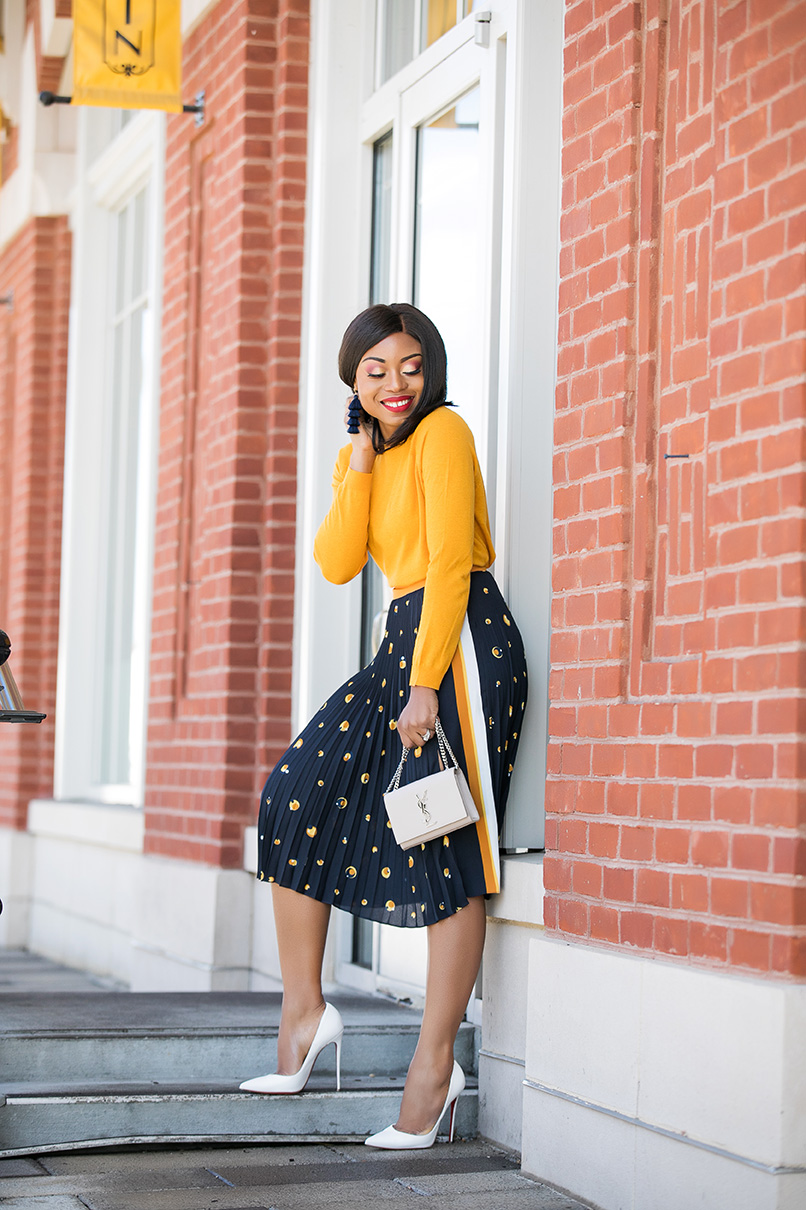 Stella-Adewunmi-of-jadore-fashion-shares-her-work-style-in-midi-print-skirt-yellow-top-white-pumps