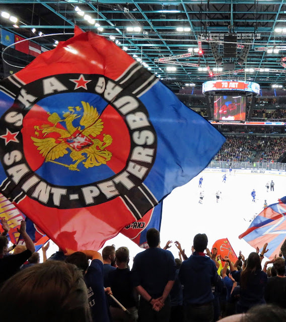 Flag-waving St. Petersburg SKA ice hockey fans at a Russian KHL game