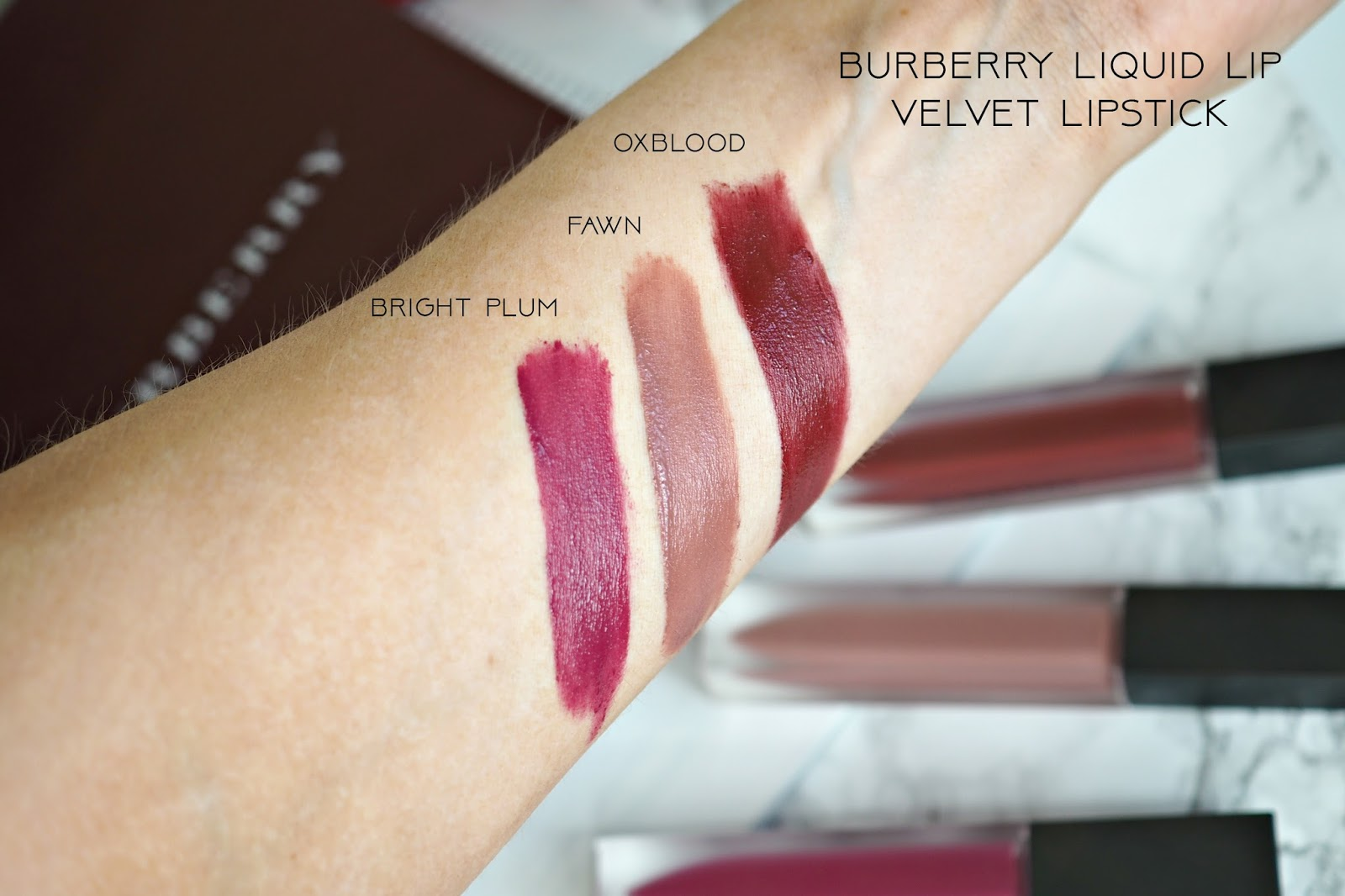 Burberry Liquid Lip Velvet Lipsticks swatches in oxblood, fawn and bright plum