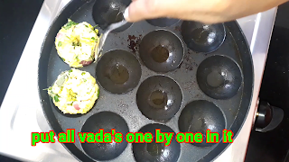 image of putting medu vadas in the mould