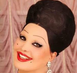 Moira Orfei rarely strayed from her trademark look, with  heavy make-up and a turban-style hairdo