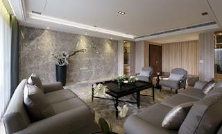 輕奢華質感客廳,在沉穩中添加了有年輕氣息的設計感。從圖右玄關處可看到強大的收納空間(鞋櫃與衣帽間)。