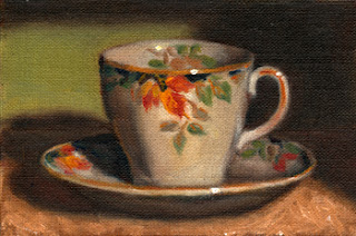 Oil painting of a tea cup and saucer with an autumn oak leaf design.