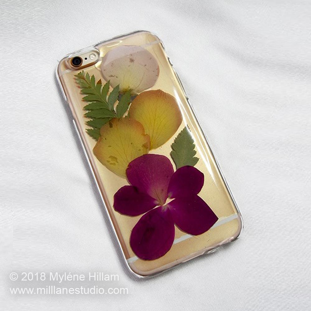 Dried flowers and petals from Mother's Day bouquet embedded in resin on a mobile phone case