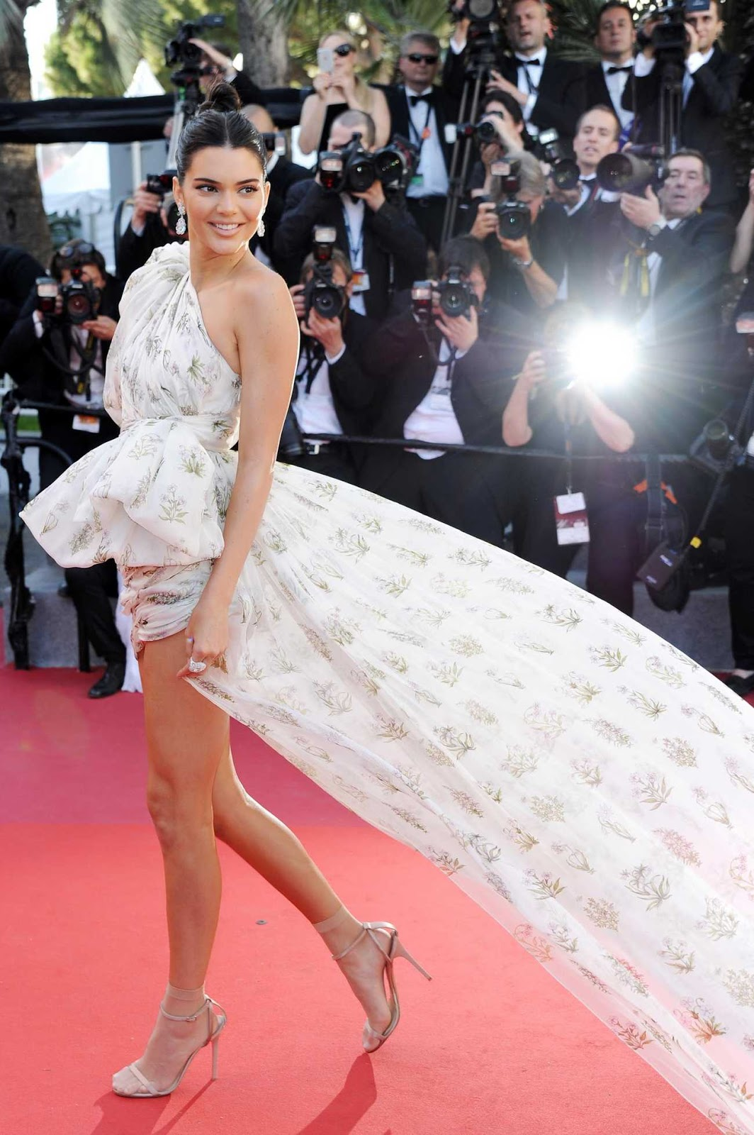 Kendall Jenner puts legs on show in billowing mini dress at the 2017 Cannes Film Festival