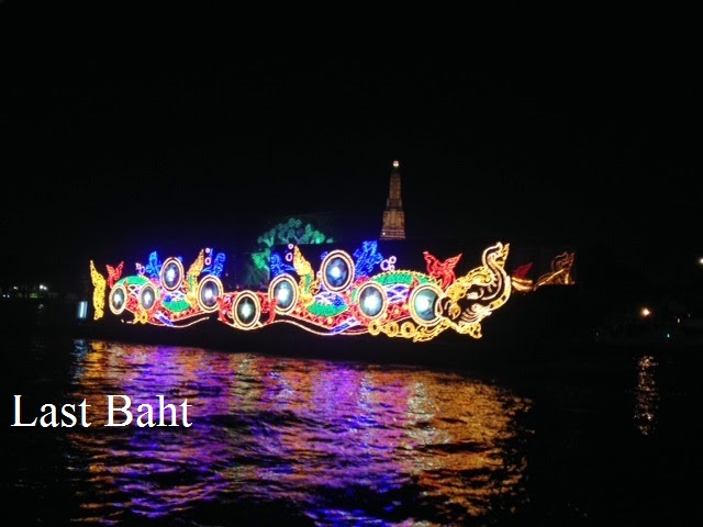 brightly-lit floats sail down the Chaophraya river in Bangkok for the light festival