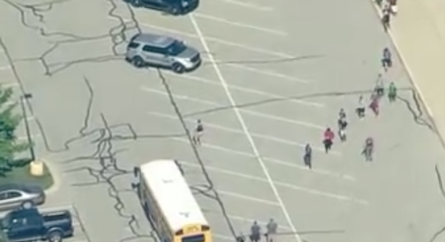 'Hero' teacher ran at gunman, tackled him to ground, student says: 'He pretty much protected all of us'