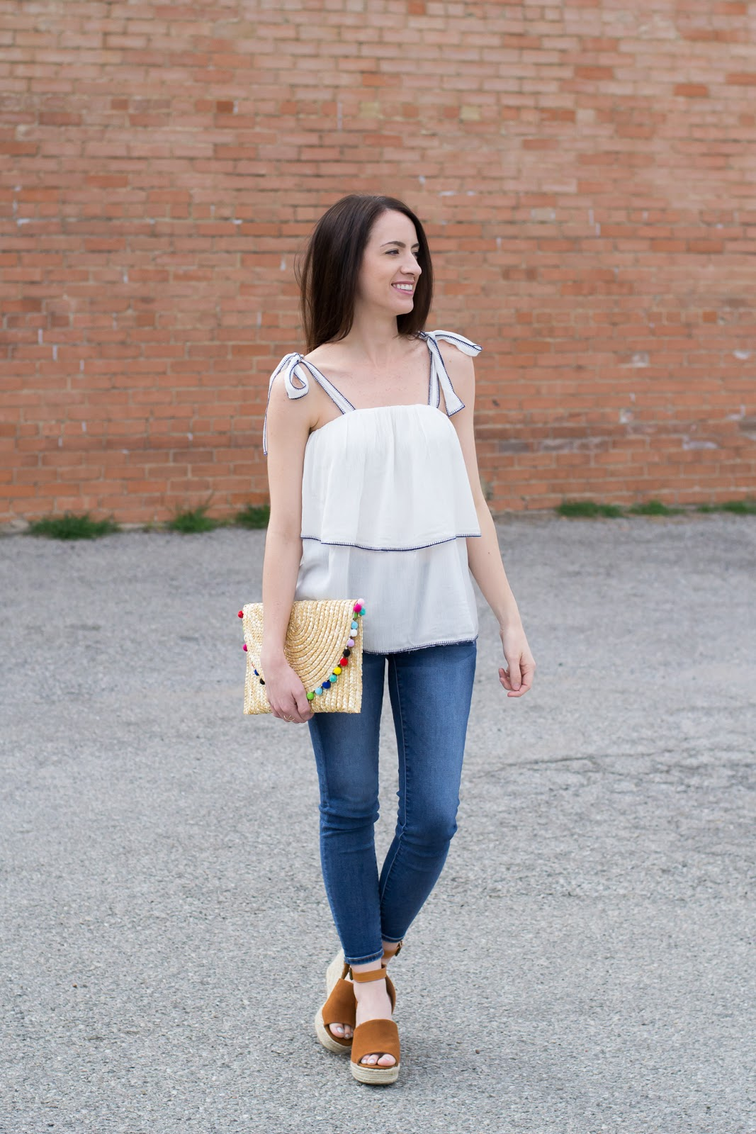 Summer ruffle top and straw pom pom clutch