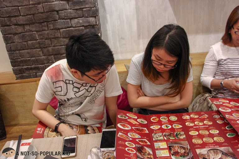 Jeff and Jojo Cheng browsing through Shi Lin's menu