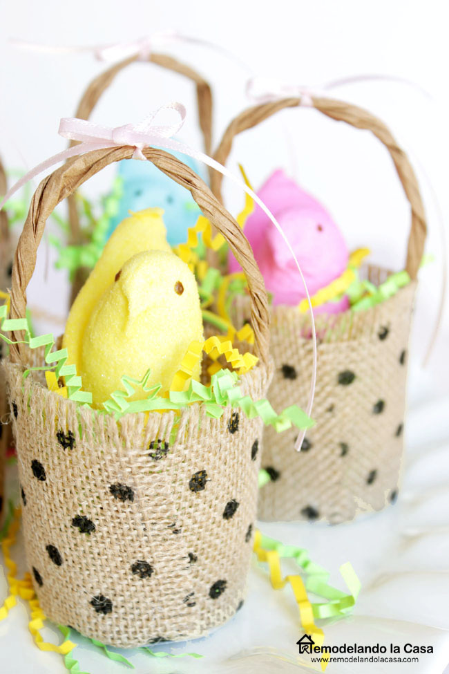 yellow, blue and pink peeps inside little burlap baskets