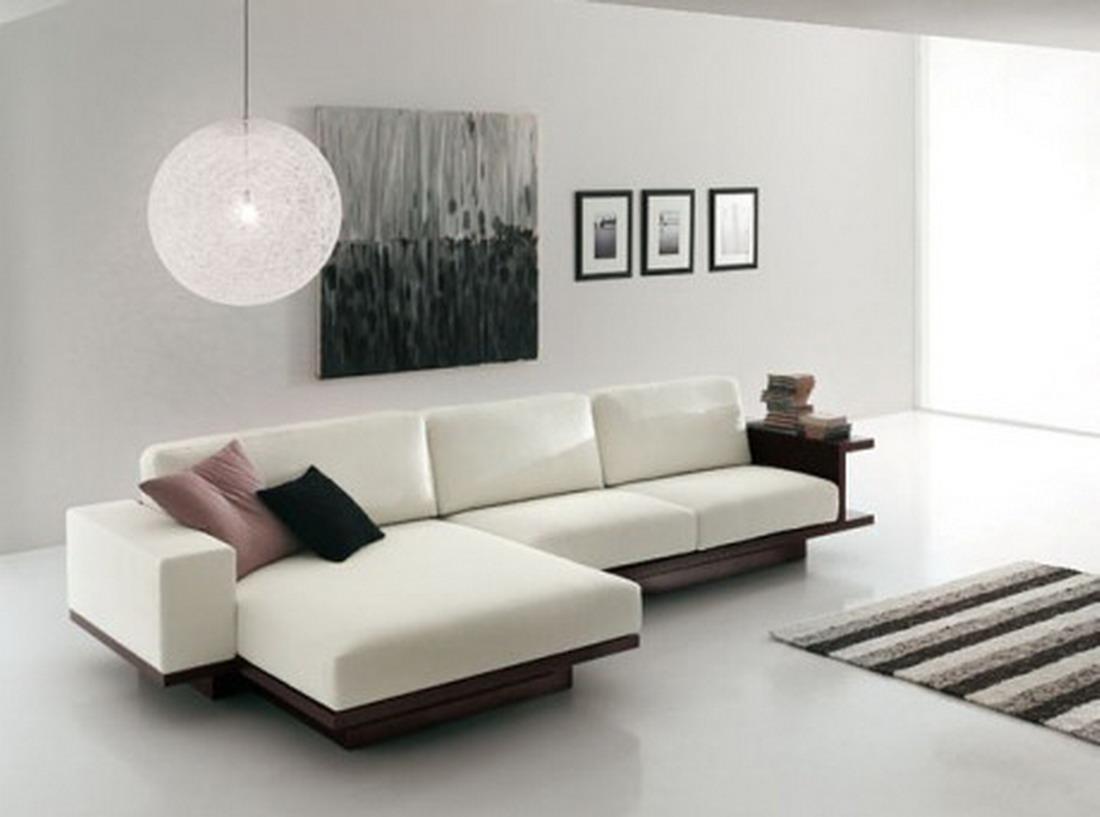 una pared con un cuadro de gran formato y tres pequeos al lado es un buen ejemplo para esta decoracin moderna y simplista diseo minimalista para sala