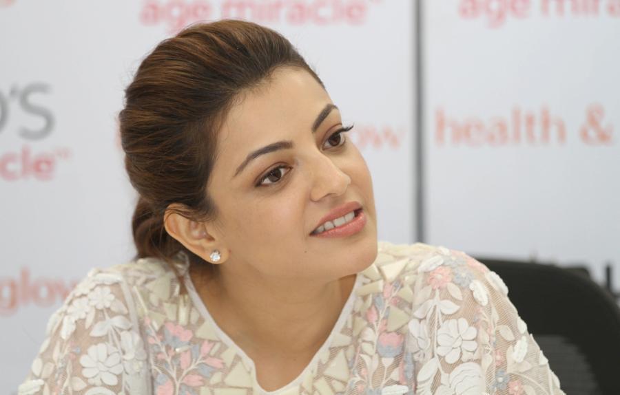 Actress Model Kajal Aggarwal Smiling Stills In White Dress