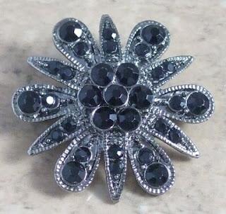 Starflower black brooch 1990s