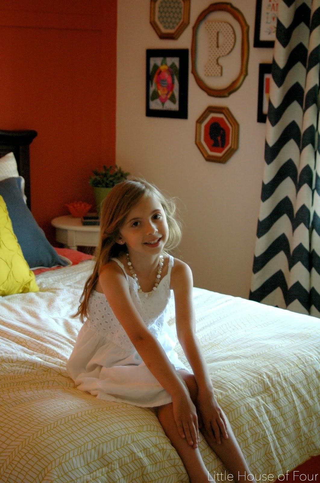 Little girl on her bed