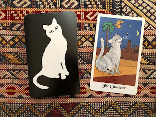 The Chanteur card shows a cat singing at night. By artist David Borden