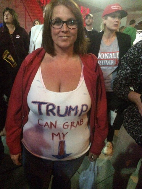A middle age female deplorable with Trump Can Grab My shirt