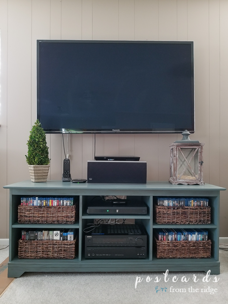 painted media console with baskets for dvds