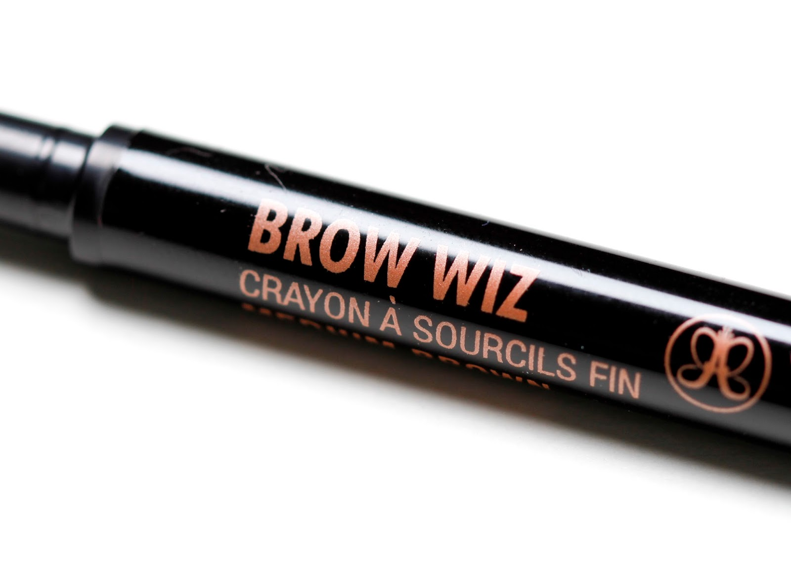 closeup shot of bronze lettering detail on side of brow wiz crayon