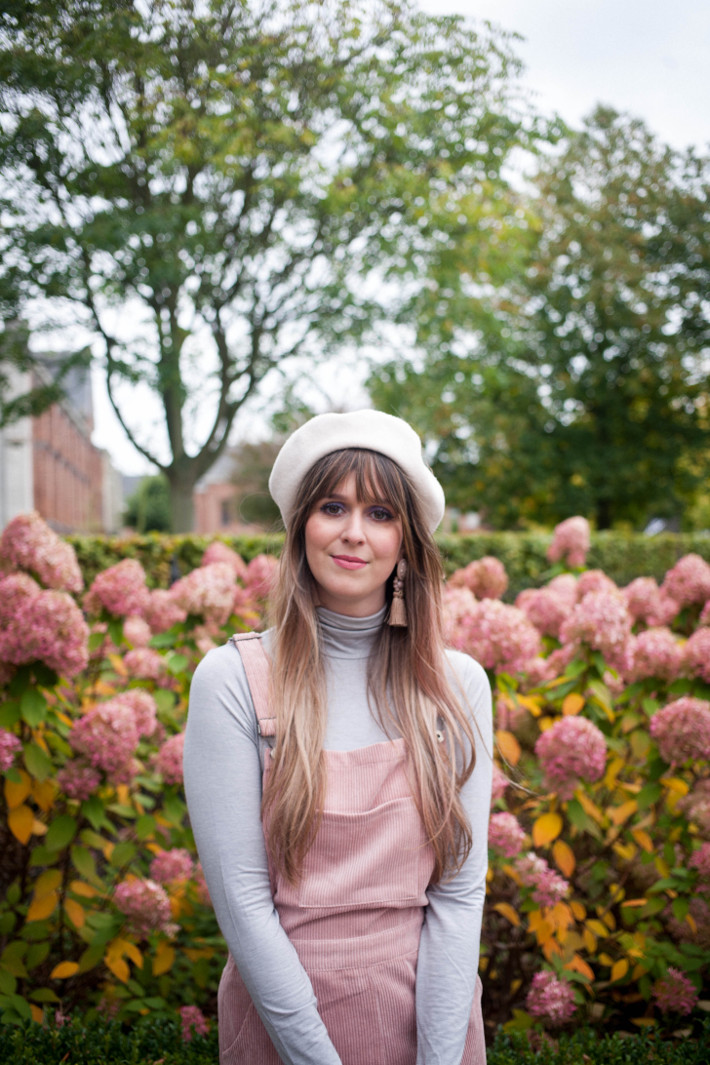 Outfit: pink corduroy pinafore layered over turtleneck
