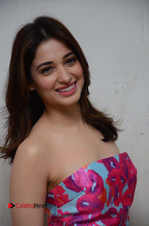 Actress Tamanna Latest Images in Floral Short Dress at Okkadochadu Movie Promotions  0083.JPG