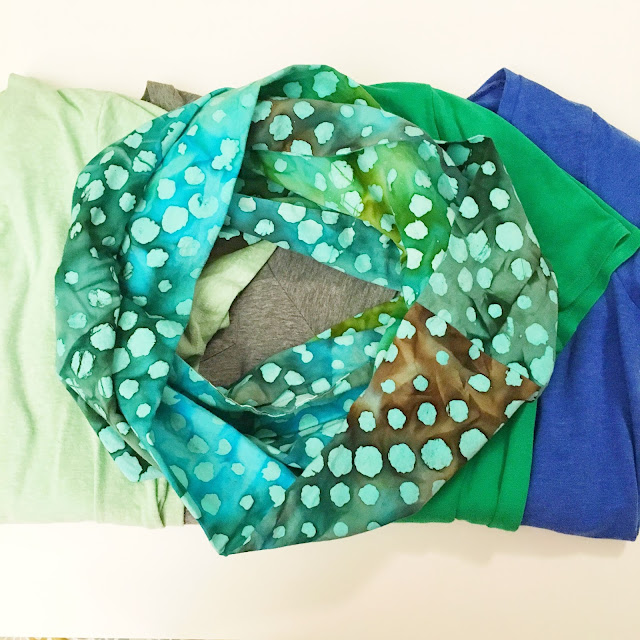 Travel infinity scarf flat lay with shirts
