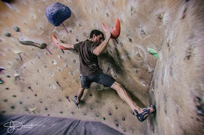 climbing-on-plastick-climbing-holds