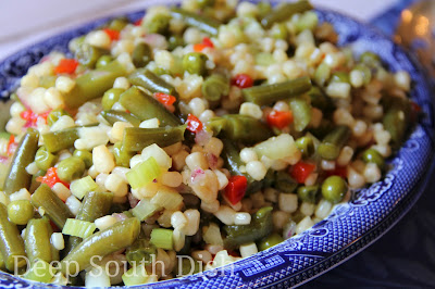 A classic vegetable salad of corn, green beans, and peas, marinated in a sweet and sour vinegar and sugar dressing.
