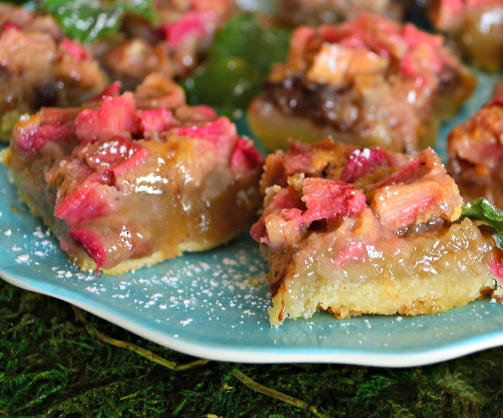 Rhubarb and Black Pepper Shortbread bars are filled with rhubarb and strawberry jam. A hint of back pepper gives these a touch extra! This is a great spring dessert. #rhubarb #cookies #barcookies #dessert www.thisishowicook.com