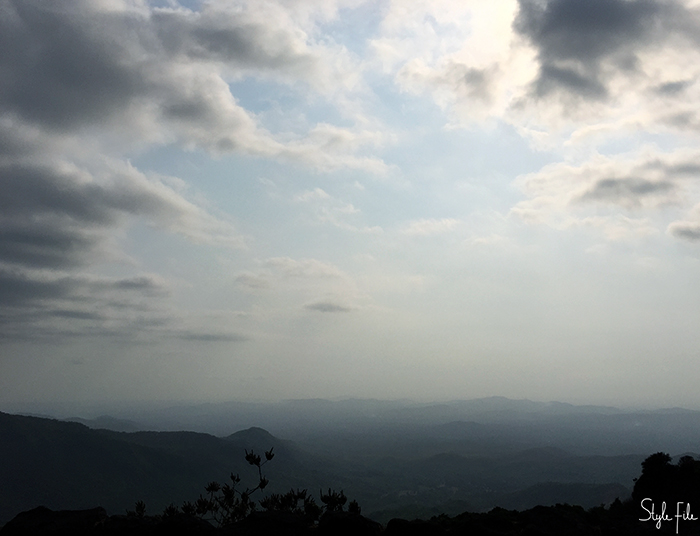 Image of a dark grey sky surrounded by clouds on top of the mountains and hills in Goa