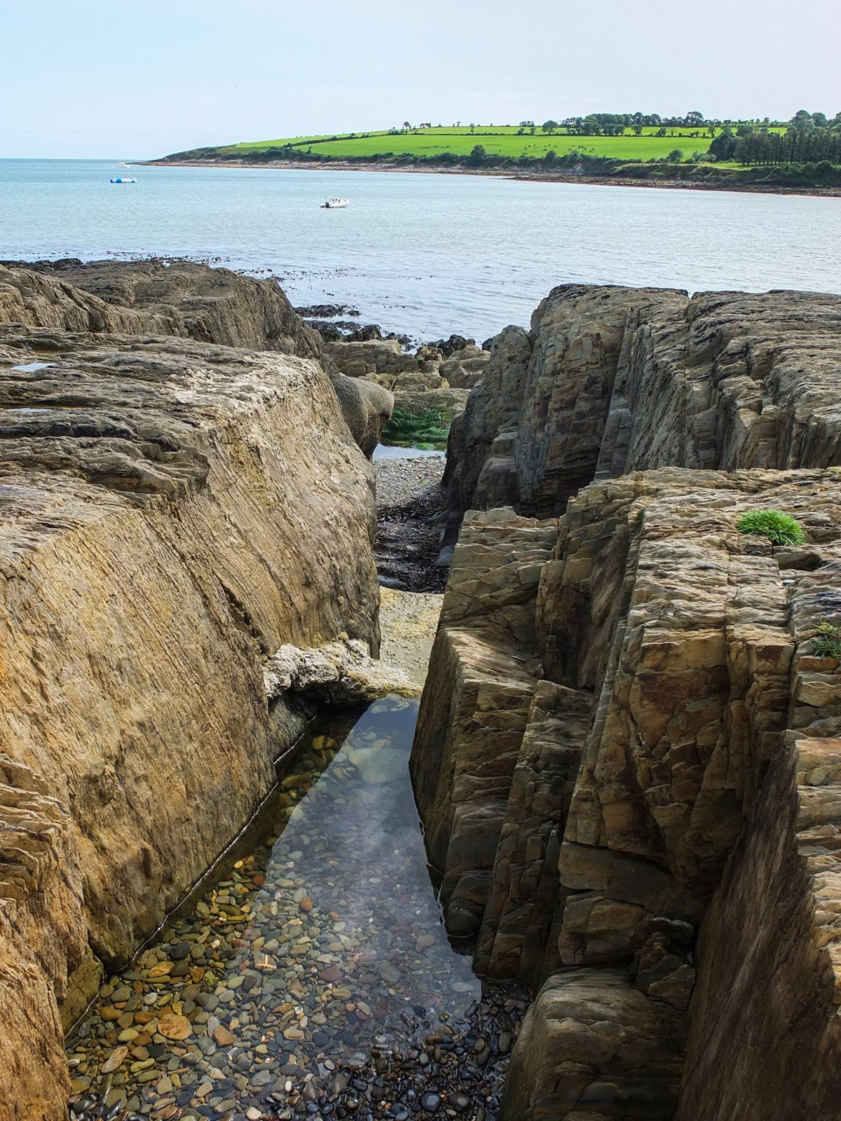 A waterpool between rocks on the beach in Fountainstown, County Cork.