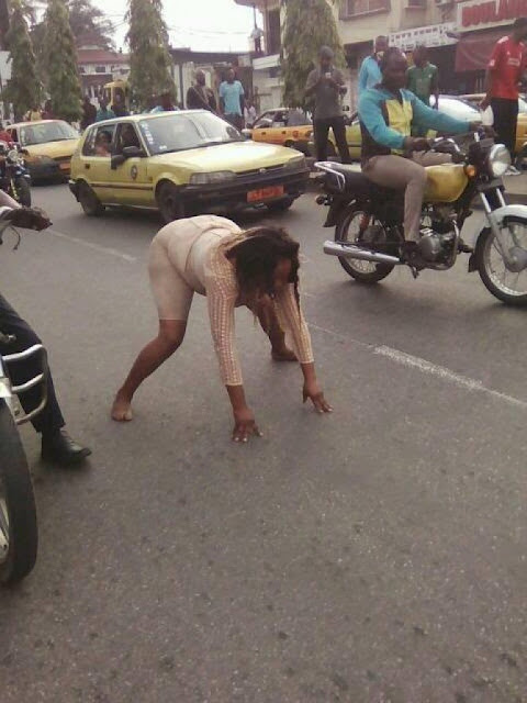 SHOCKING!! Woman Parks Posh Prado And Goes Insane On The Streets Of Douala