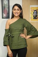 Pragya Jaiswal in a single Sleeves Off Shoulder Green Top Black Leggings promoting JJN Movie at Radio City 10.08.2017 087.JPG