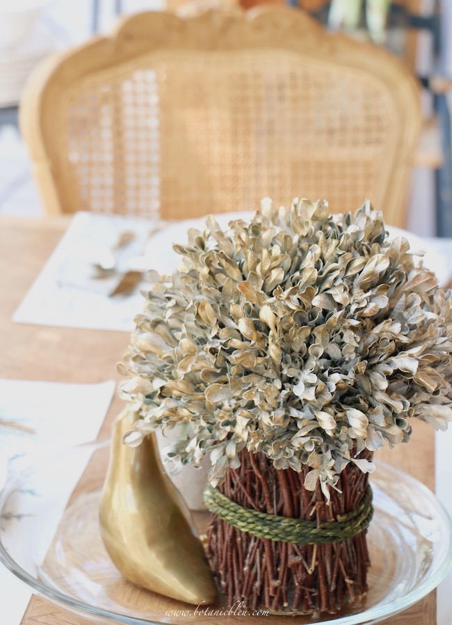 white and gold painted boxwoods for a French table setting
